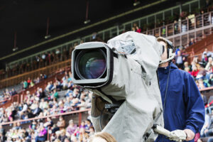 Cameraman In Front of Racecourse Grandstand