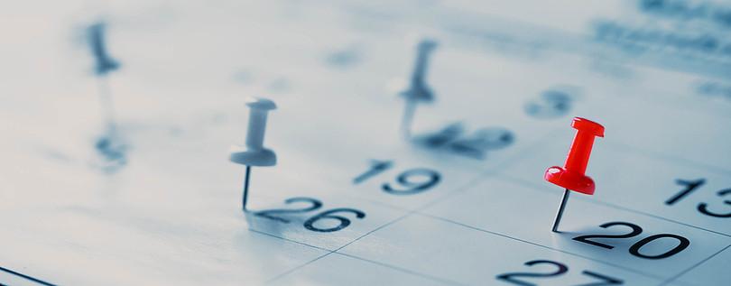 Pins in Blurred Calendar